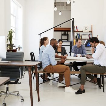creative-team-meet-at-a-table-in-an-office-one-PWP9HT6.jpg