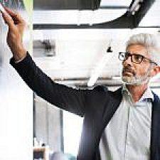 mature-businessman-with-gray-hair-in-the-office-PJ8CDSM-150x150.jpg